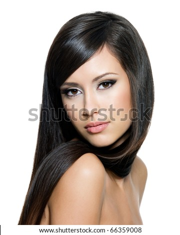 Pretty woman with long straight brown hair looking at camera,  isolated on white background