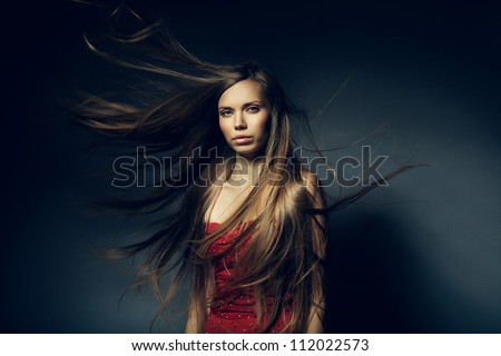 pretty woman with long windy hair - stock photo