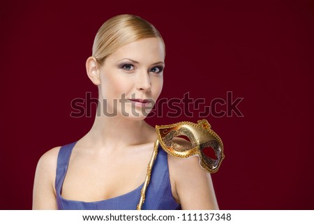 Pretty woman with masquerade mask, isolated on purple