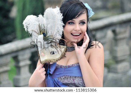 Pretty woman with patterned masquerade mask