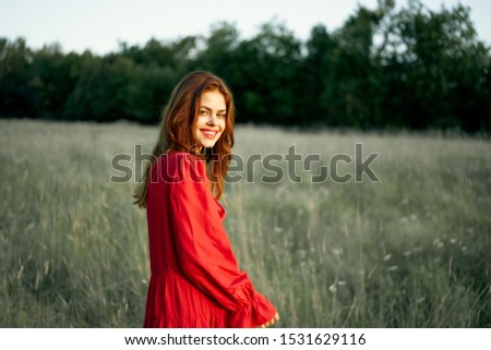 pretty woman with pretty smile in red clothes