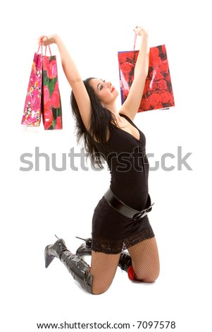 pretty woman with shopping bags isolated on the white background