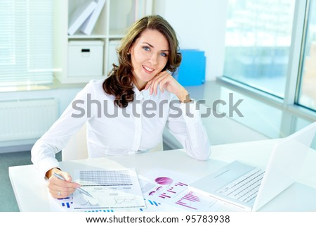 Pretty woman working at office on a workday