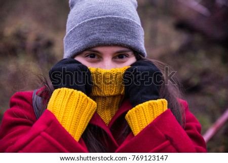 pretty woman wrapping up in a sweater outside in cold weather day #769123147