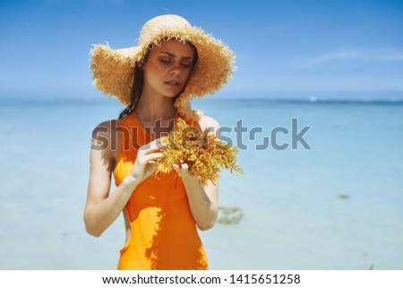pretty woman yellow swimsuit beach hat ocean vacation travel vacation nature #1415651258