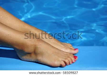 Pretty women foot with blue water background