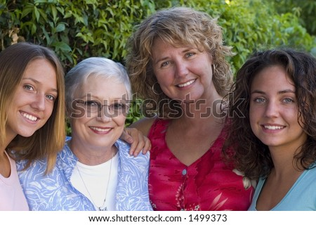 pretty women making up three generations of a family.