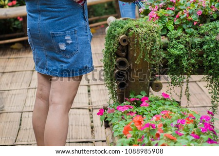 pretty women 's ass in tight jeans.sexy girl showing her butt in tight short jeans short. women is on the stroll in garden.