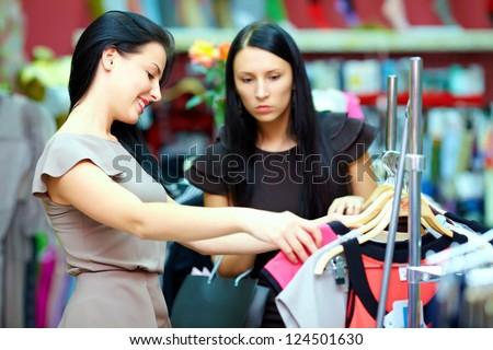 pretty women shopping in retail store