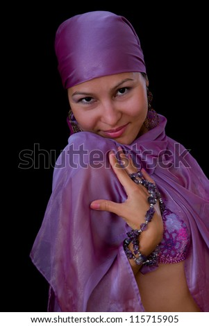 Pretty young Asian Muslim woman - belly dancer isolated on black background