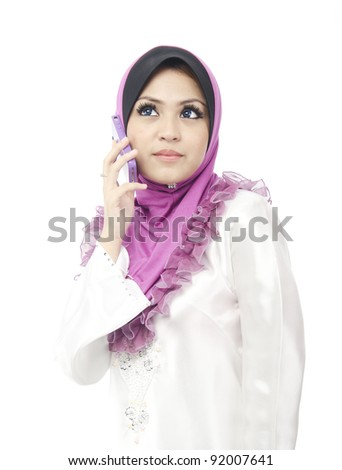 Pretty young Asian Muslim woman hold her phone while looking at above.