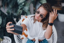 Pretty Young Beauty Woman Using Laptop in cafe, outdoor portrait business woman, hipster style, internet, smartphone, office, Bali Indonesia, holding, mac OS, manager, freelancer , make selfie, watch