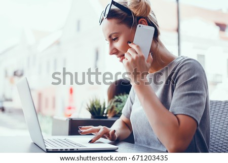 Pretty Young Beauty Woman Using Laptop in cafe, outdoor portrait business woman, hipster style, internet, smartphone, office, Bali Indonesia, holding, mac OS, manager, freelancer  call, sunglasses #671203435