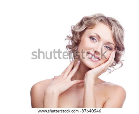 pretty young blond woman with curly hair touching her cheek and neck and looking down, isolated against white