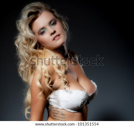Stock Photo Pretty young blonde female posing in white lingerie