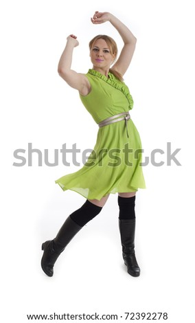 Pretty young blonde girl in green retro dress isolated against white