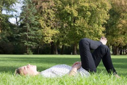 pretty young blonde girl lye on grass relax time and cheerful woman