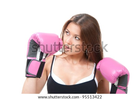 Pretty young boxing woman standing and defending by hands in pink and black box gloves isolated on a white background