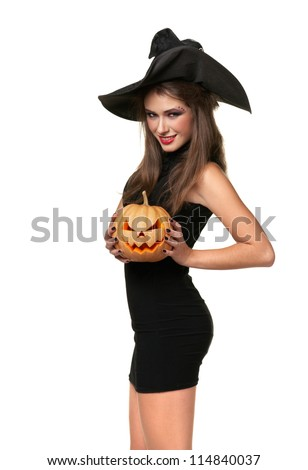pretty young brunette woman dressed as a fairy with a pumpkin