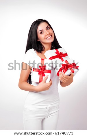 pretty young brunette woman dressed in white clothes with many presents