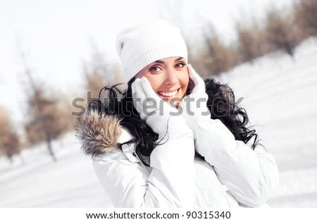 pretty young brunette woman wearing warm winter clothes outdoor