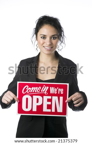 Pretty young businesswoman with a Come in Were Open sign