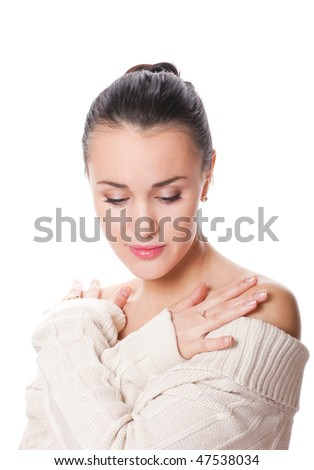 pretty young caucasian woman with eyes closed wearing a white sweater