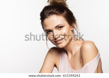 Pretty young charming smiling woman close-up on a white background