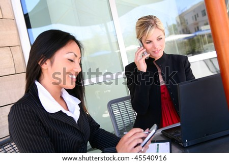Pretty, young, diverse business woman team at office working