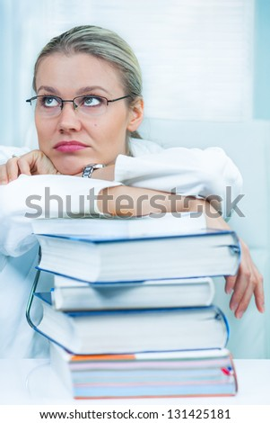 Pretty Young Female Medical Student Is Tired of Studying Medical Books