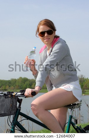 Pretty Young Female Riding Bike at Outdoor Park