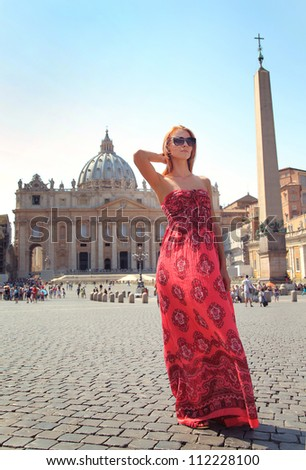 Pretty young female tourist at St. Peter's square in the Vatican City in Rome