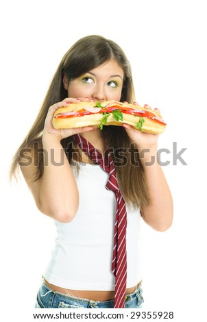 pretty young girl eating a huge sandwich, isolated against white background