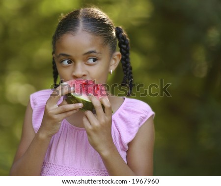 Pretty young girl eating watermelon.