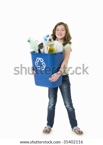 Pretty young girl holding blue recycle bin on white background