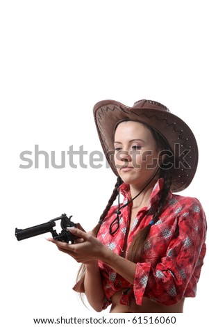Pretty young girl in the cowboy hat with two pigtails check  his revolver - stock photo