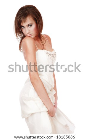 Pretty young girl in wedding dress looking with hesitating expression