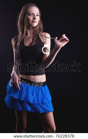 pretty young girl play with handcuff look at you