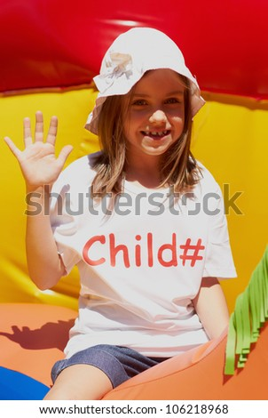 Pretty young girl posing outdoors in a bright sunny day with beautiful smile