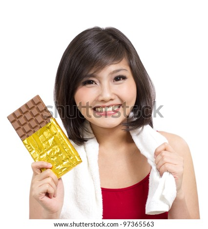 pretty young girl showing chocolate after exercise