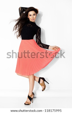 Pretty young girl wearing pink skirt