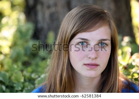 pretty young girl with freckles outside