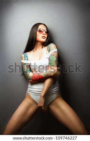 pretty young girl with tattoo. lovely woman.