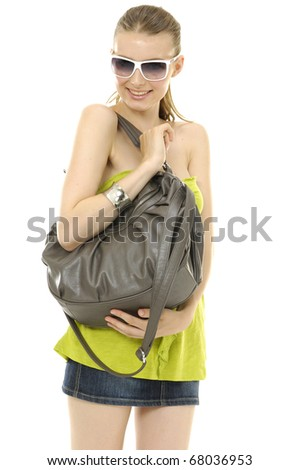 pretty young happy woman with fashion sunglasses and handbag