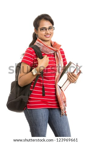 pretty young Indian girl student posing with books.