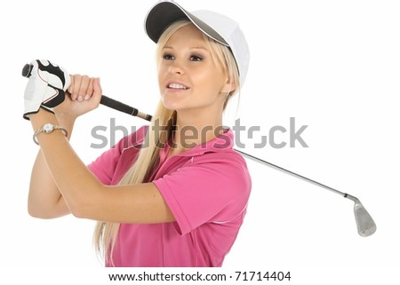 Pretty young lady golfer looking into the distance