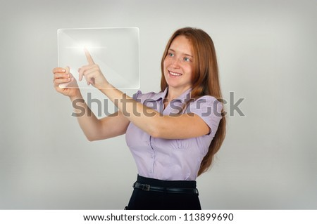 Pretty young lady press button on touch screen