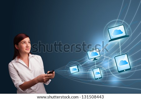 Pretty young lady typing on smartphone with cloud computing