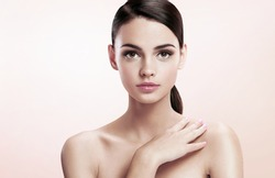Pretty young lady with professional make-up, skin care concept / photoset of attractive brunette girl on beige background