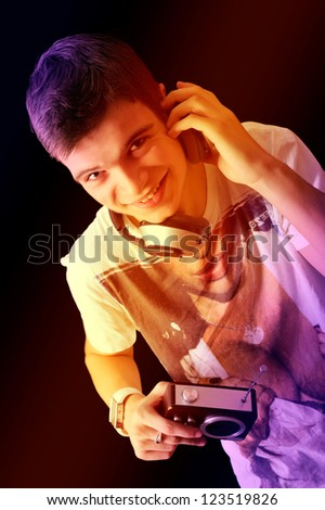 Pretty young man in phones with an old radio